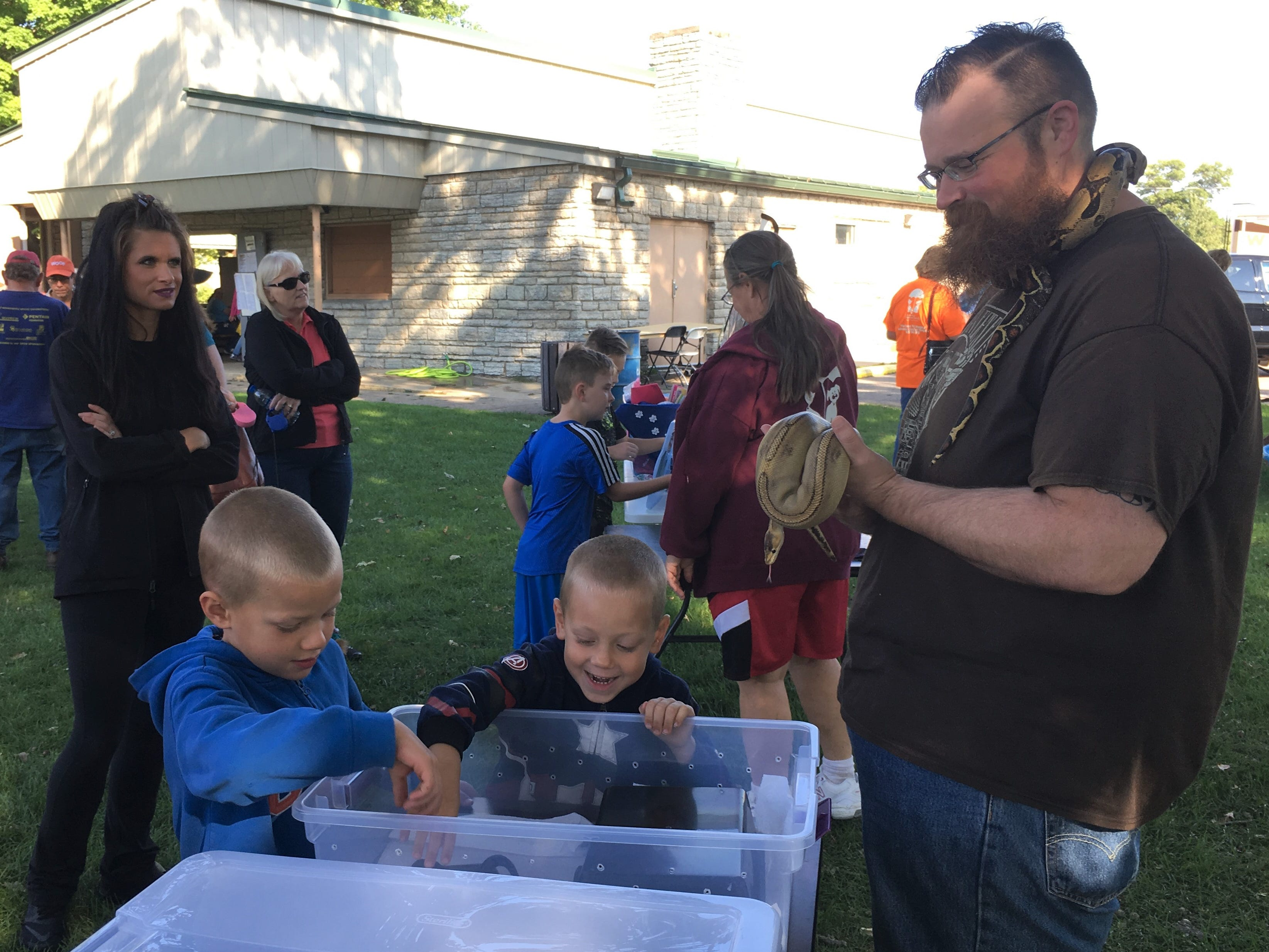 Attendees could face their fears by meeting a friendly, neighborhood snake Saturday, Sept. 8 at Bark to the Future. The 30th annual Tri-County Humane Society Companion Walk celebrated the decade the shelter was born — the 1980s — while raising money for the nonprofit at Wilson Park in St. Cloud.