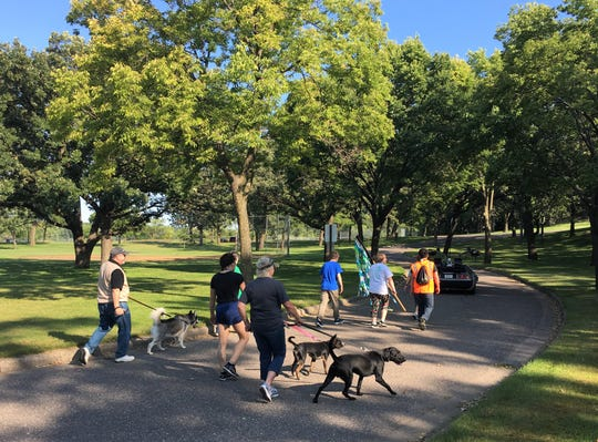 Dogs and their humans walk in Wilson Park in St. Cloud on Saturday, Sept. 8 during the Tri-County Humane Society Companion Walk.
