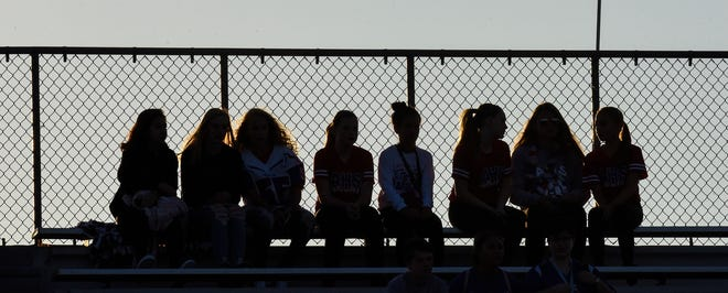 Fans sit on the top row of bleachers during the Friday, Sept. 7, game at Apollo High School in St. Cloud.