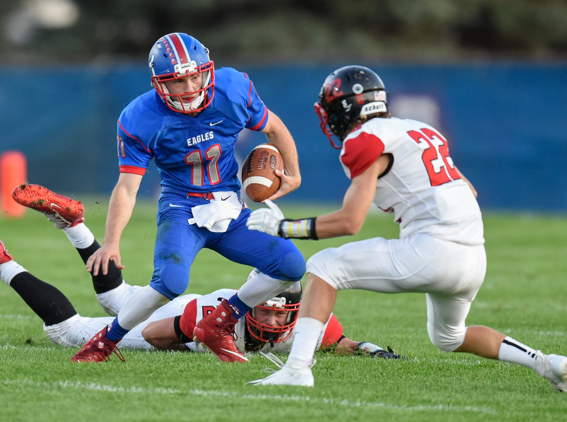 Apollo quarterback Neal Benson carries the ball during the Friday, Sept. 7, game at Apollo High School in St. Cloud.
