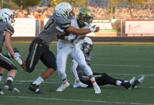 Desert Hills LB Jarron Polu (33) was one of the best linebackers in Region 9 and will now make a tough decision between Dixie State and SUU after receiving official offers from both schools.