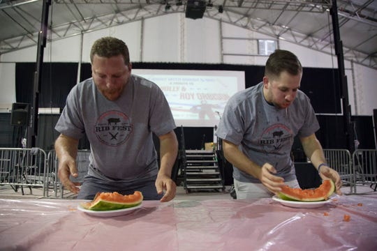 Competitors take on the watermelon-eating contest at the CasaBlanca Rib Fest on Friday, Sept. 7, 2018.