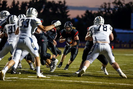 SPASH's Jack Kelly attempts to advance through Appleton North defense during a football game between SPASH and Appleton North in Stevens Point, Wis., September 7, 2018.