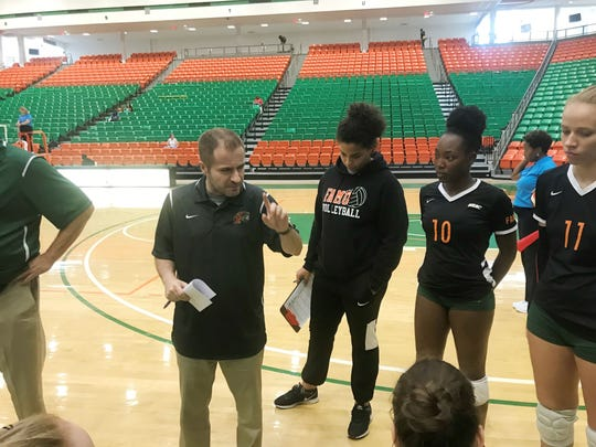 FAMU Coach Gokhan Yilmaz discusses strategy with the team during a timeout.