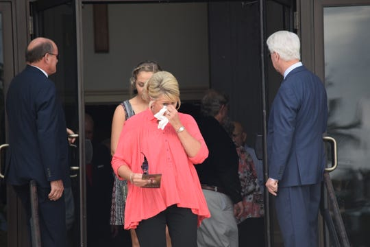 A mourner leaves Mike's funeral on Sept. 8, 2018