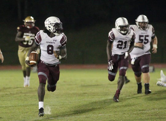 Madison County quarterback Travis Jay runs for a 55-yard touchdown as the Cowboys beat Florida High 33-17 on Friday, Sept. 7, 2018.