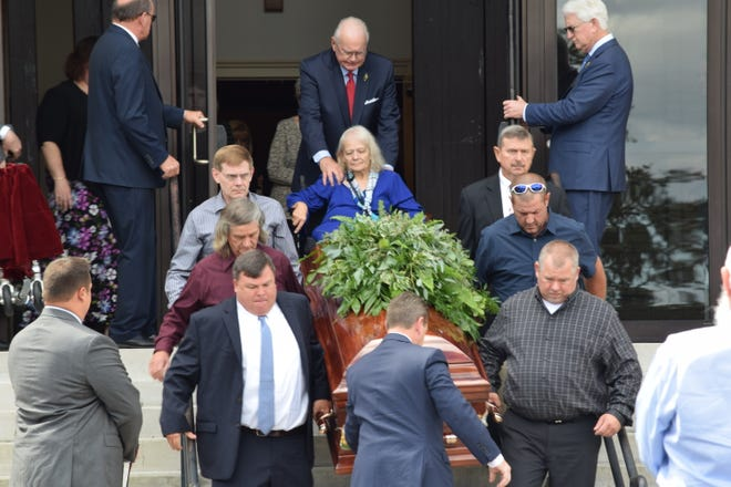 Cheryl Williams (center) watches as the casket of her son, Mike Williams is loaded into a hearse by pallbearers Cliff Fitzgerald, James Spearman Jr., Brett Ketcham, William Thursby, Michael Spearman and Nick Williams on Sept. 8,2018.