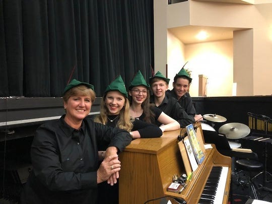 """From left, Karen Wiggins, Samantha Kmetz, Elizabeth Forrest, Leif Clark, Brandon Shaw as the Pit Orchestra for a production of """"Peter Pan"""" at the Vero Beach High School Performing Arts Center."""