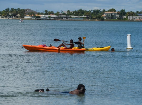 Parkgoers enjoy fun in the sun Saturday, Sept. 8, 2018, while barbecuing, kayaking, playing on the beach, and more at Jaycee Park in Fort Pierce.
