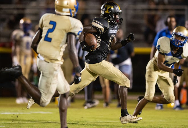 Treasure Coast's Tyrec Thompson runs the ball downfield for a touchdown against Mainland (Daytona Beach) on Friday, Sept. 7, 2018, at South County Stadium in Port St. Lucie. The Titans lost their regional quarterfinal game Friday, Nov. 9, 2018, to Riverview 41-22.