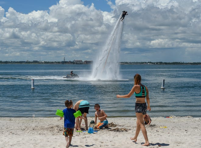 Parkgoers enjoy fun in the sun Saturday, Sep. 8, 2018, while barbecuing, kayaking, playing on the beach, and more at Jaycee Park in Fort Pierce. The city of Fort Pierce is considering a new ordinance that would prohibit kayaking, jet skiing, people bringing barbecue grills, having a bounce house, playing music at the park that can be heard more than 100 feet away, and using the restroom to shower and bathe unless shower facilities are specifically provided for public use. Also, skating and skateboarding would only be allowed in designated areas.