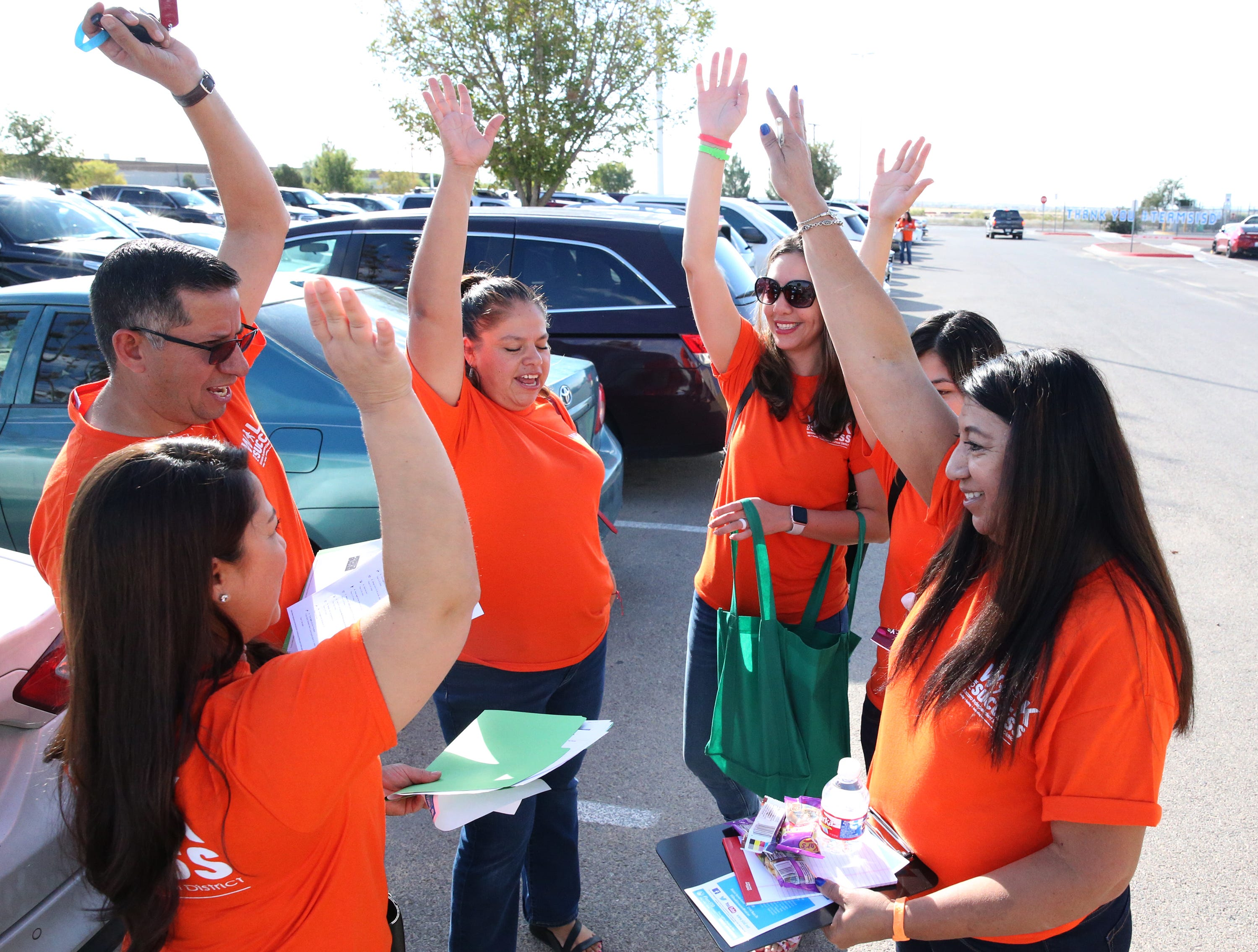 "Gabriela Elliott, top right, principal at Bill Sybert K-8 School leads a Socorro school district team in a cheer before heading out to meet with high school students who are no longer enrolled in school during the district's 5th Annual Walk for Success Saturday at district's service center at 1244 Rojas Drive. Over 300 district teachers, counselors, administrators and others sought out 156 students to encourage them to finish school and earn a diploma. The number is down from the first year of Walk for Success when they sought 300 students who had left school. ""Were not going to give up on them,"" said district superintendent Jose Espinoza, 'Thats what this is about.' The district's graduation rate, which stands at 91.3 percent is in part dependent on the success of this effort, he added. Cory Craft, academic compliance officer with the Socorro school district said options such as an alternative high school, online learning and creative scheduling at their home campus are ways the district can help them earn a diploma. William Serrata, president of El Paso Community College was on hand to lend support to the effort. ""They really take it seriously. They treat every student as if it was their own child,' he said. 'If they don't graduate from high school we can't enroll them at the college.'"