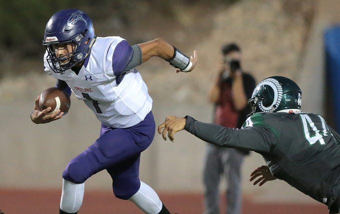 Eastlake quarterback Orion Olivas slips past Montwood linebacker David Marentes during their game Friday at the SAC.