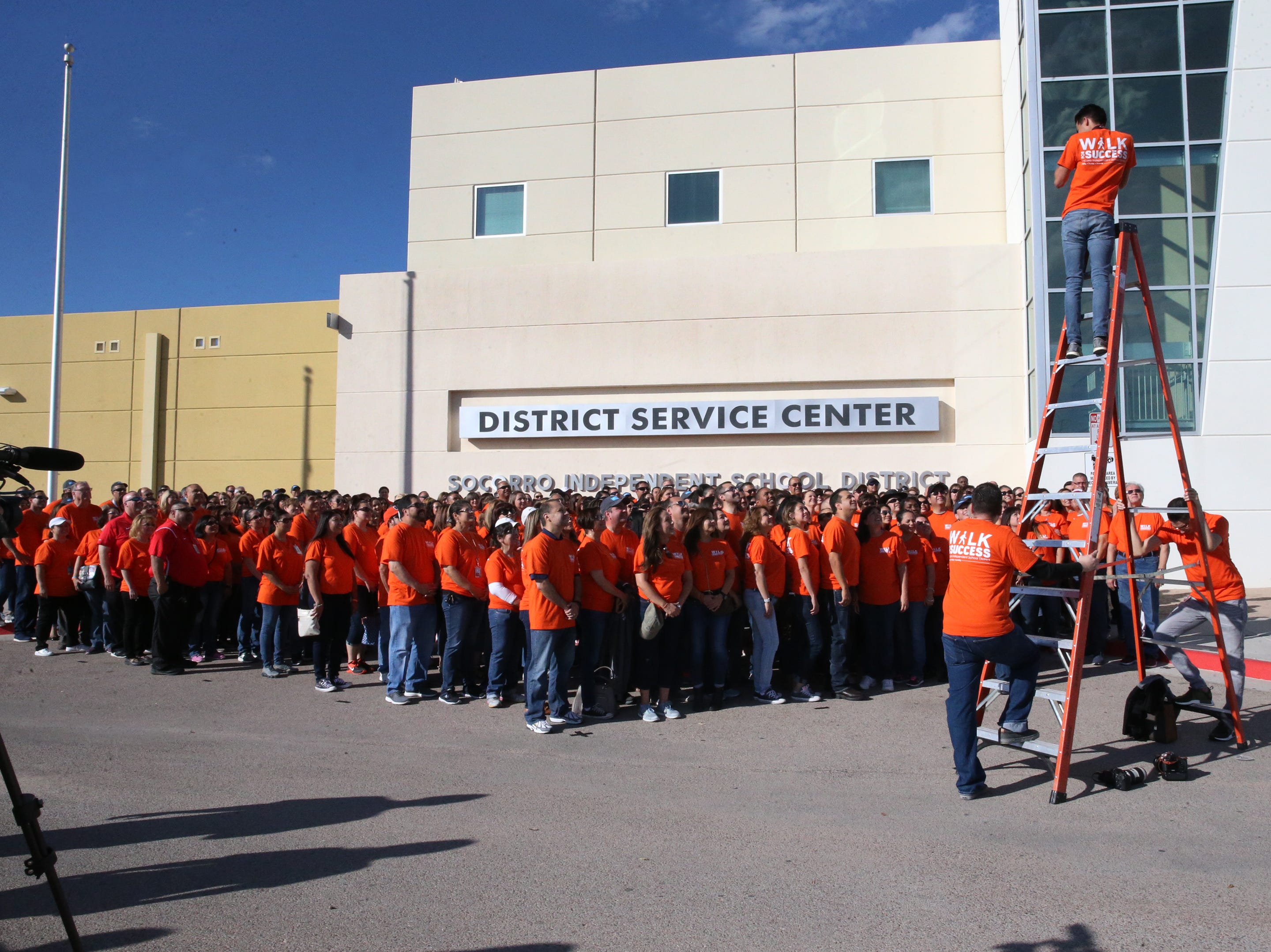 Socorro school district employees pose for a group shot before embarking on their 5th annual Walk for Success Saturday at the District's service center at 12440 Rojas Drive.