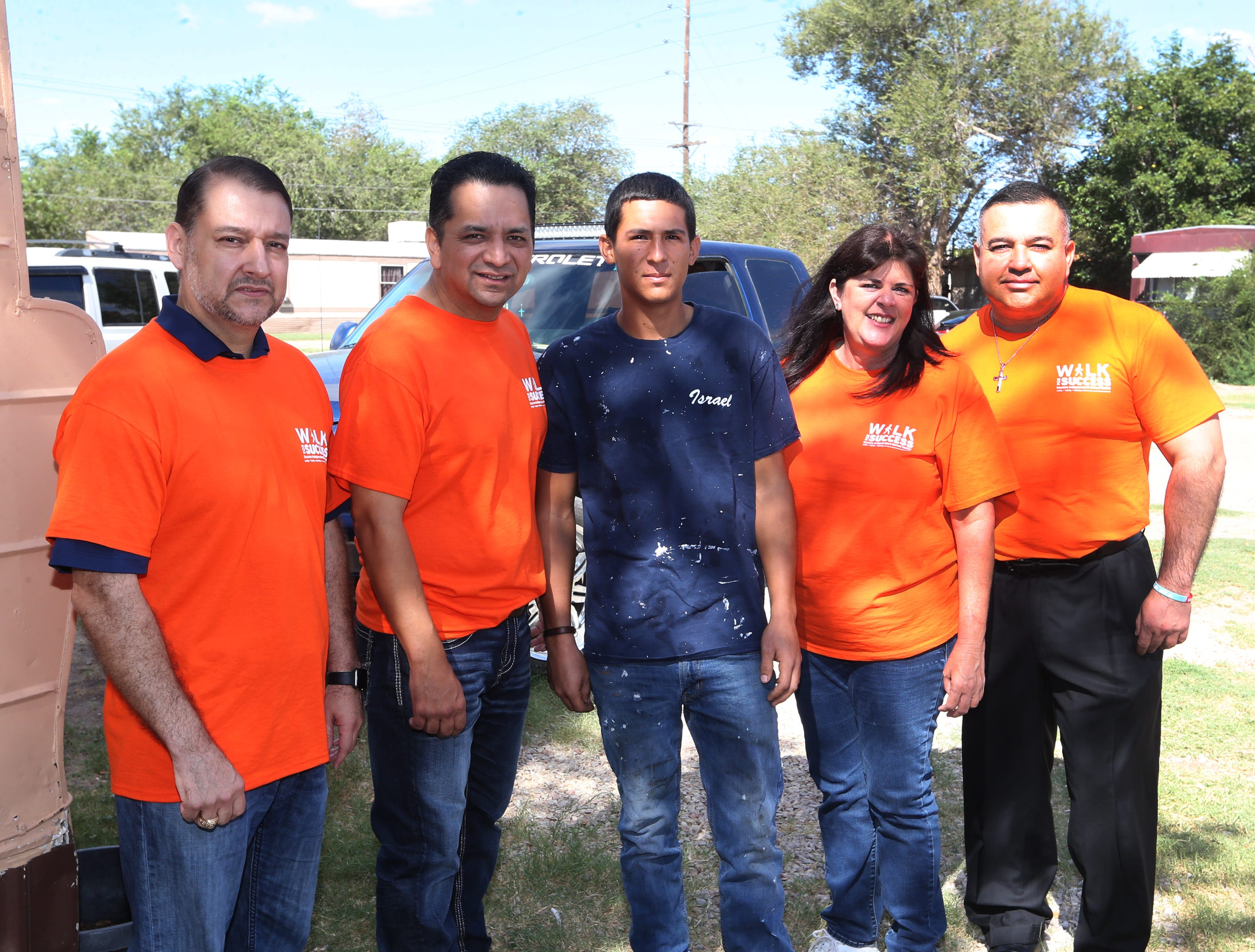 A Socorro school district team poses with student Israel Rubio, center, during the district's 5th annual Walk for Success Saturday. They are from left: EPCC president William Serrata, Socorro school district superintendent Jose Espinoza, Socorro district board president Cynthia Najera and Socorro High School principal Josh Tovar.