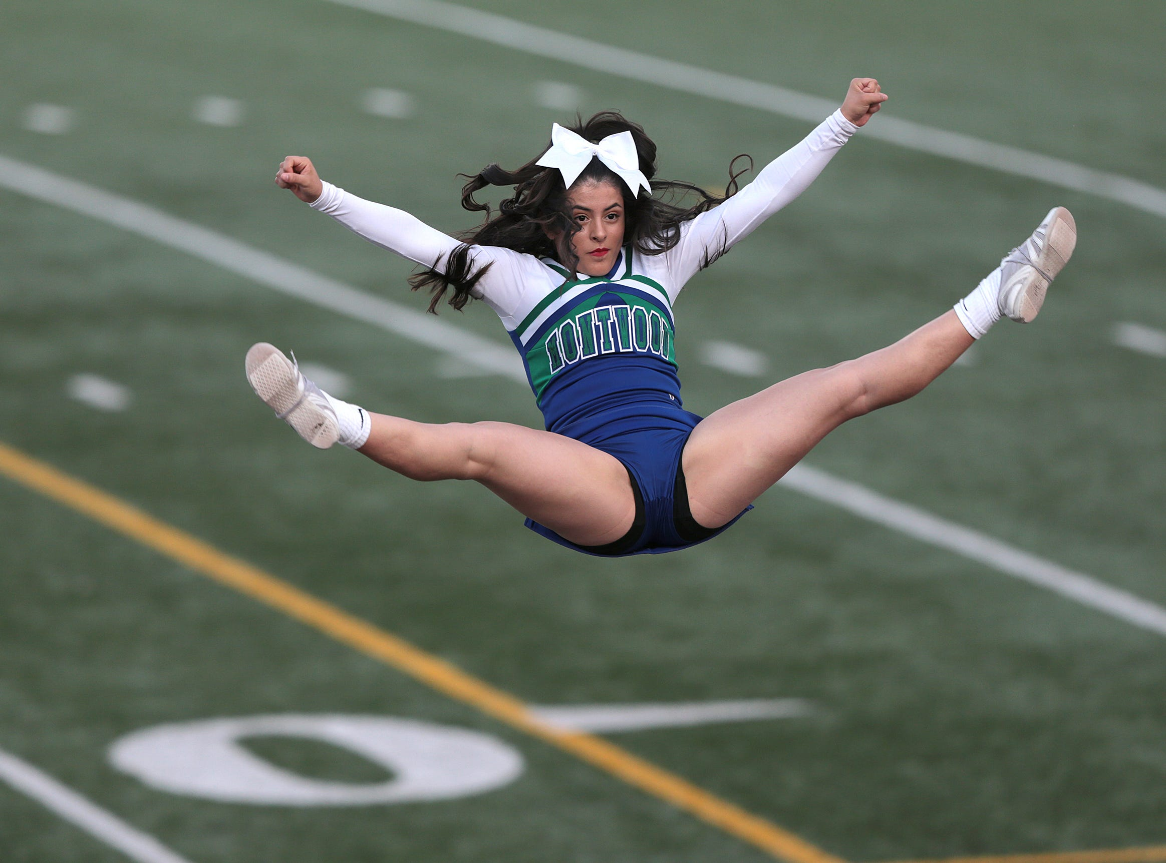 A Montwood cheerleader soars high above the SAC field Friday.