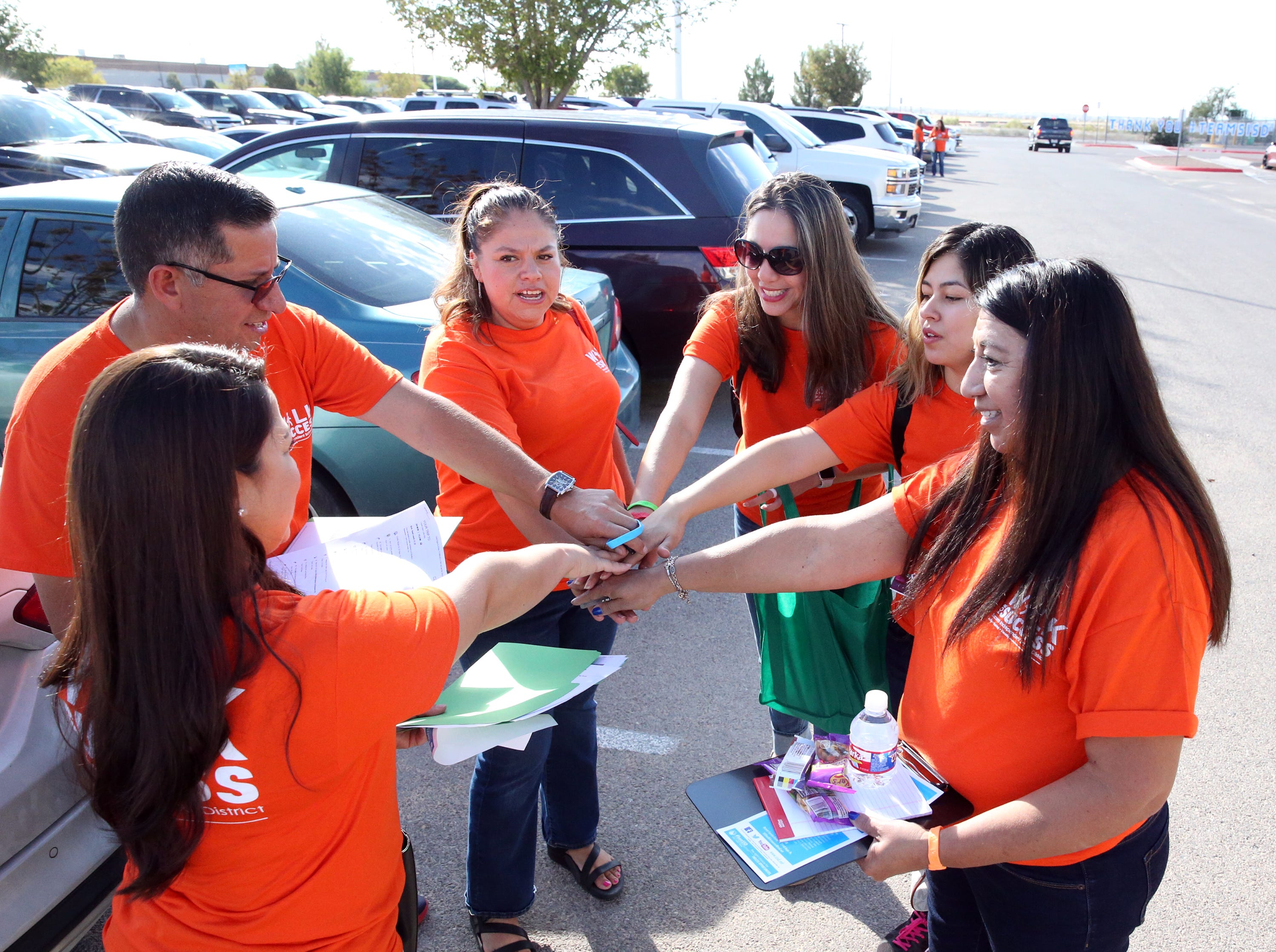 "Gabriela Elliott, top right, principal at Bill Sybert K-8 School leads a Socorro school district team in a cheer before heading out to meet with high school students who are no longer enrolled in school during the district's 5th Annual Walk for Success Saturday at the district's service center at 1244 Rojas Drive. Over 300 district teachers, counselors, administrators and others sought out 156 students to encourage them to finish school and earn a diploma. The number is down from the first year of Walk for Success when they sought 300 students who had left school. ""Were not going to give up on them,"" said district superintendent Jose Espinoza, 'Thats what this is about.' The district's graduation rate, which stands at 91.3 percent is in part dependent on the success of this effort, he added. Cory Craft, academic compliance officer with the Socorro school district said options such as an alternative high school, online learning and creative scheduling at their home campus are ways the district can help them earn a diploma. William Serrata, president of El Paso Community College was on hand to lend support to the effort. ""They really take it seriously. They treat every student as if it was their own child,' he said. 'If they don't graduate from high school we can't enroll them at the college.'"
