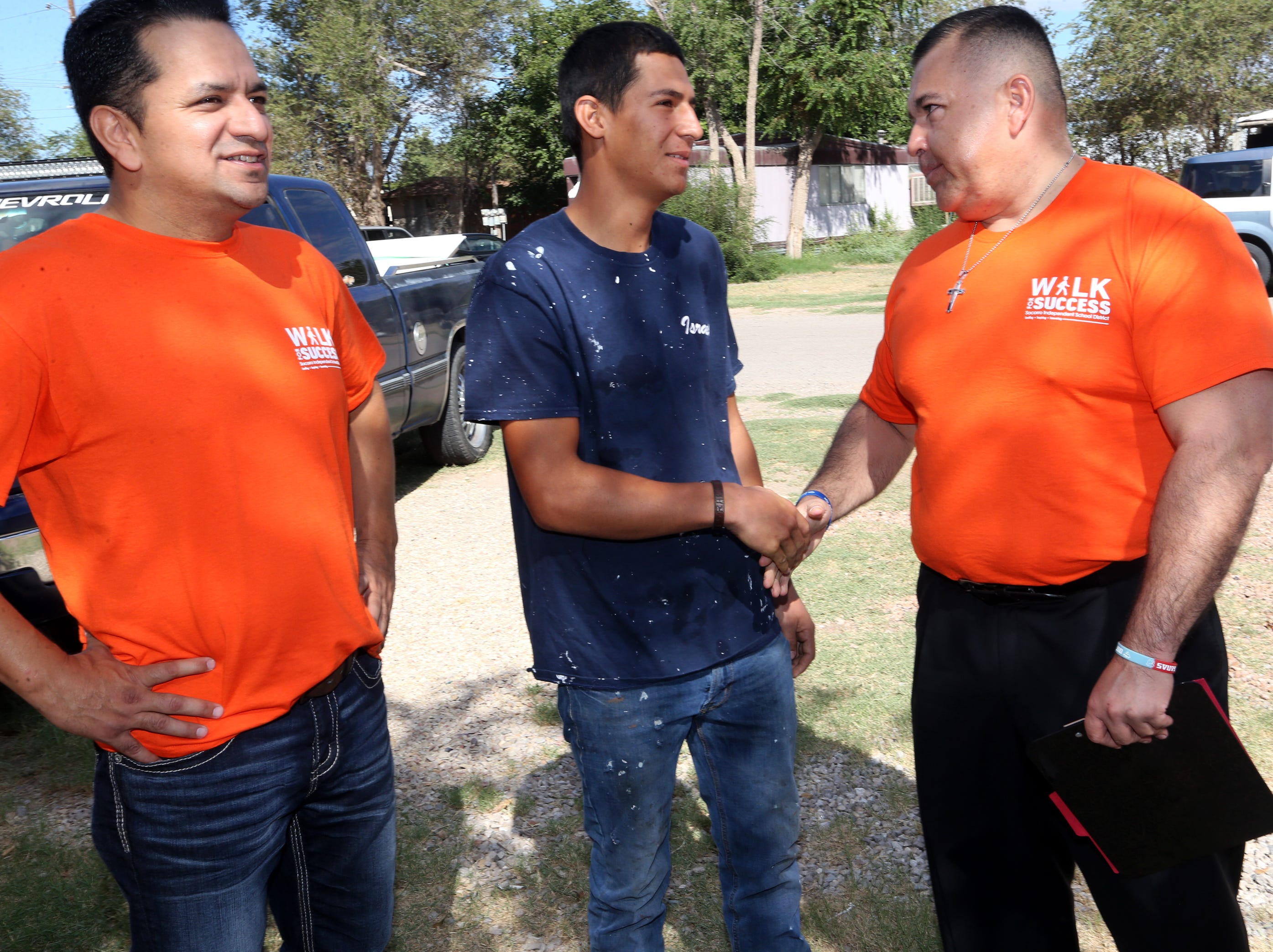Socorro High School principal Josh Tovar, right, and Socorro School district Jose Espinoza, left, meet with Israel Rubio, 18, who left high school after his junior year outside his Socorro home Saturday. The team convinced the young man to meet with Tovar Monday morning.
