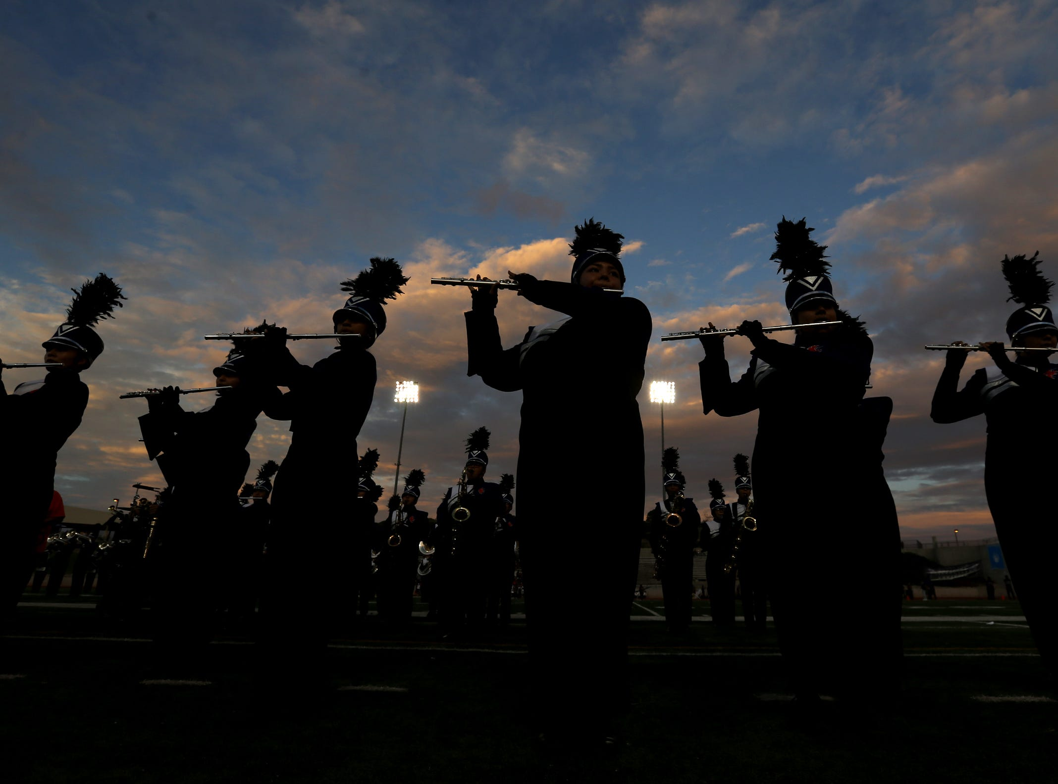 The Montwood High School marching band drum majors perform a pregame show Friday night at the SAC.