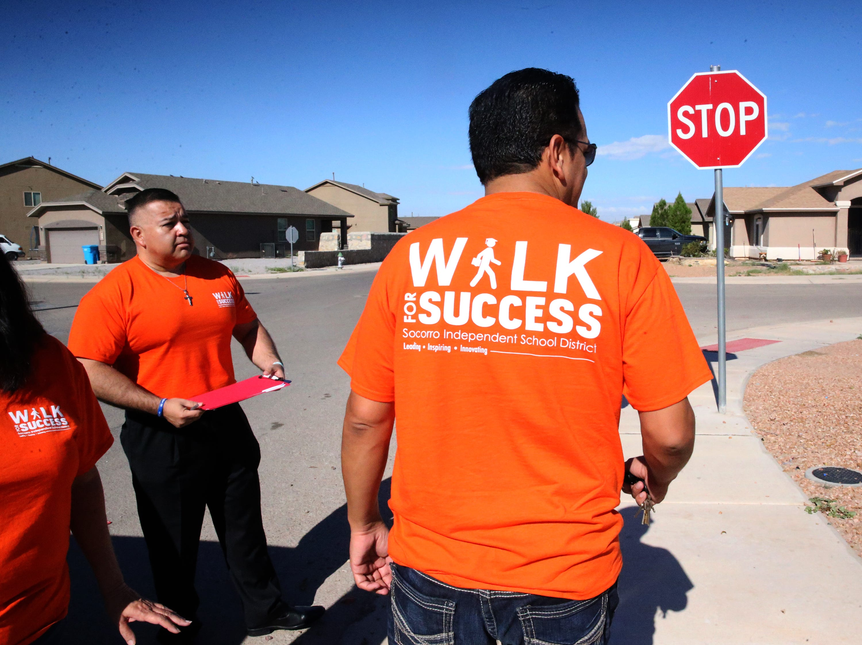 Socorro school district superintendent Jose Espinoza, right, prepares to visit a student who did not re-enroll Saturday. At left is Socorro High School principal Josh Tovar.