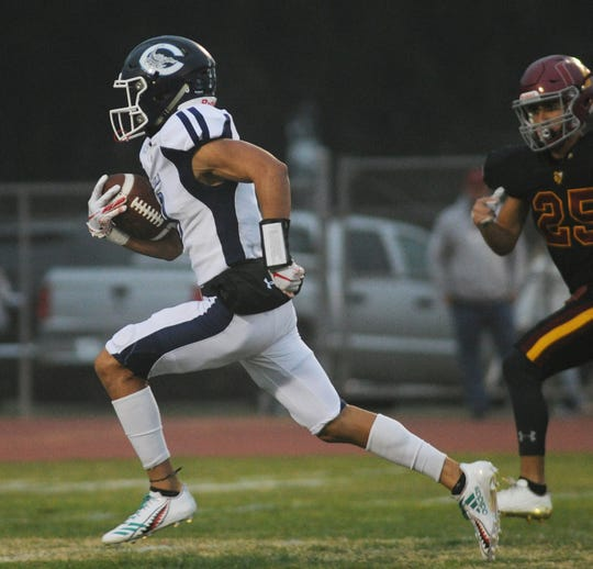 Camarillo High's Mason Brown breaks free to score a touchdown during the Scorpions' 35-19 win at Oxnard on Friday night.