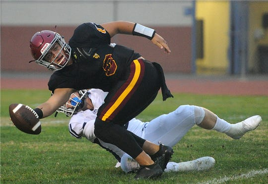 Oxnard High quarterback Vincent Walea is sacked by Camarillo's Carson Anderson during Friday night's game in Oxnard. Camarillo won 35-19 to improve to 4-0 on the season.