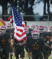 Running back Xavier Harris and Oxnard will have a new coach for the 2019 season.