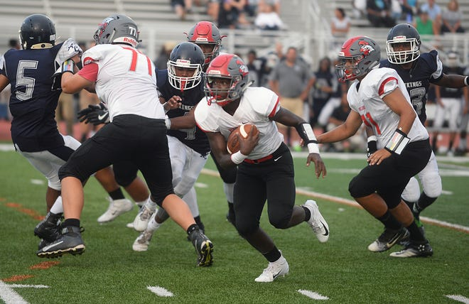 Vineland RB, Anthony Arthur (1) runs the ball down field during a game against Atlantic City on Sept. 7. The freshman has become a key component of the Fighting Clan offense this season.