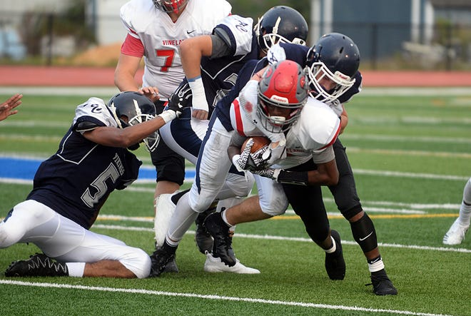 Vineland RB, Jonathan Toney Jr. (3) is tackled during a game against Atlantic City. The visiting Fighting Clan picked up their first win of the season, shutting out the Vikings 21-0 on Friday, September 7, 2018.