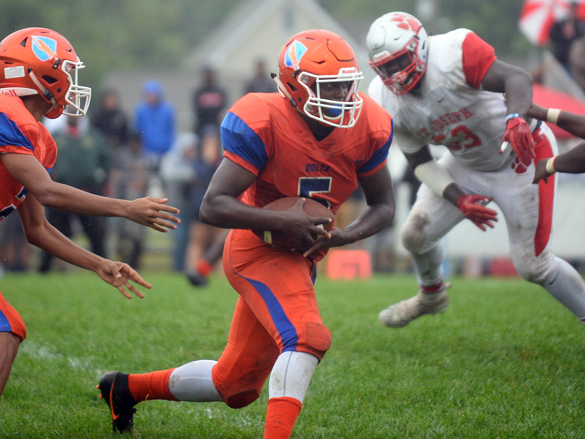 Millville RB, Tex Thompson (5) runs the ball for a short gain against St. Joseph. The visiting Thunderbolts lost the outing to the Wildcats in Hammonton on Saturday, September 8.