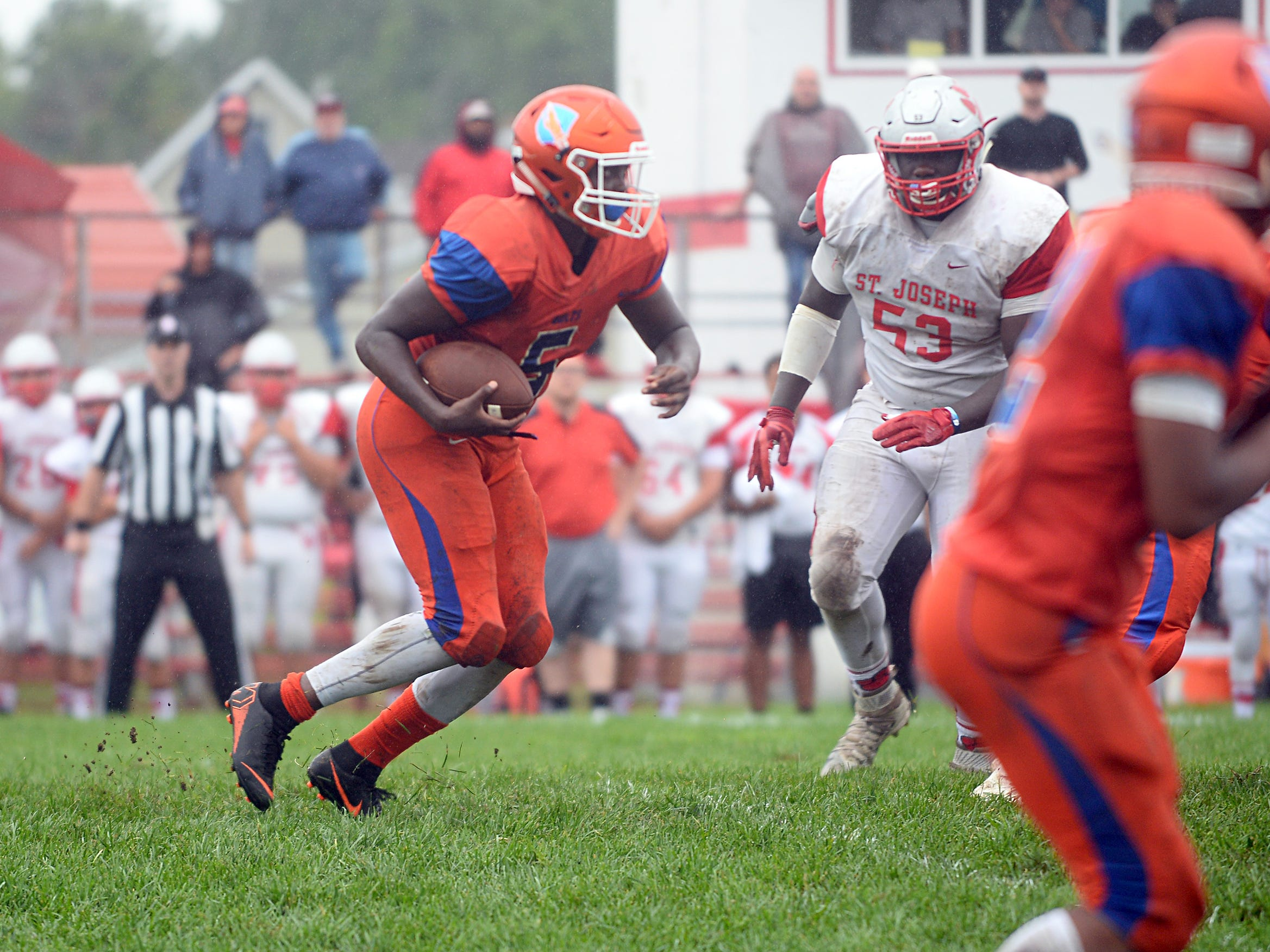 Millville RB, Tex Thompson (5) runs the ball for a gain against St. Joseph. The visiting Thunderbolts lost the outing to the Wildcats in Hammonton on Saturday, September 8.