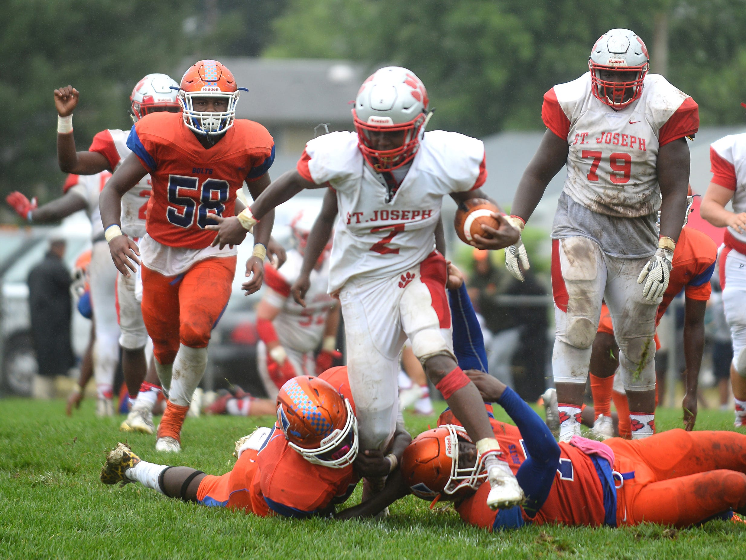 St. Joeseph RB, Ahmad Ross (2) runs the ball for a short gain against Millville on Saturday, September 8.