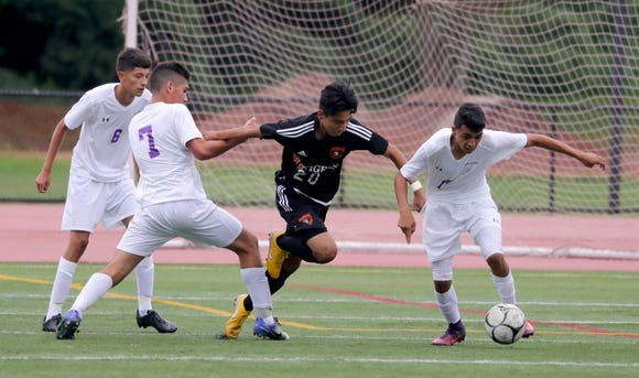Chris Puelles of White Plains battles New Rochelle during a varsity soccer match at White Plains High School Sept. 8, 2018. New Rochelle defeated White Plains 1-0.
