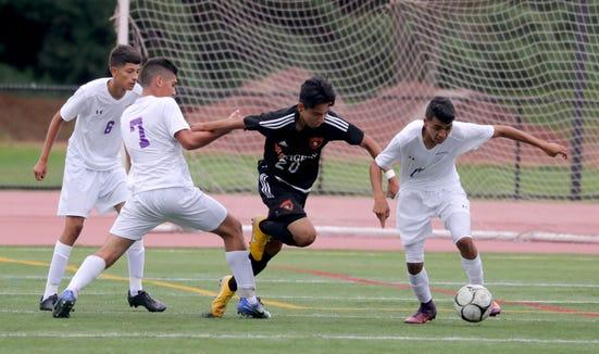 Chris Puelles of White Plains battles New Rochelle during a varsity soccer match at White Plains High School Sept. 8, 2018. New Rochelle defeated White Plains 1-0.