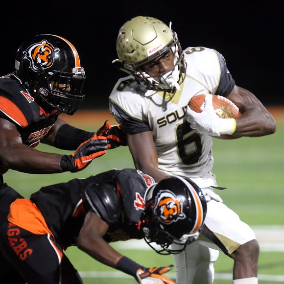 Clarktown South's Reginald Lamarre (6) pushes the ball up the field past Spring Valley's defenders during football game at Spring Valley High School on Sept. 7, 2018.