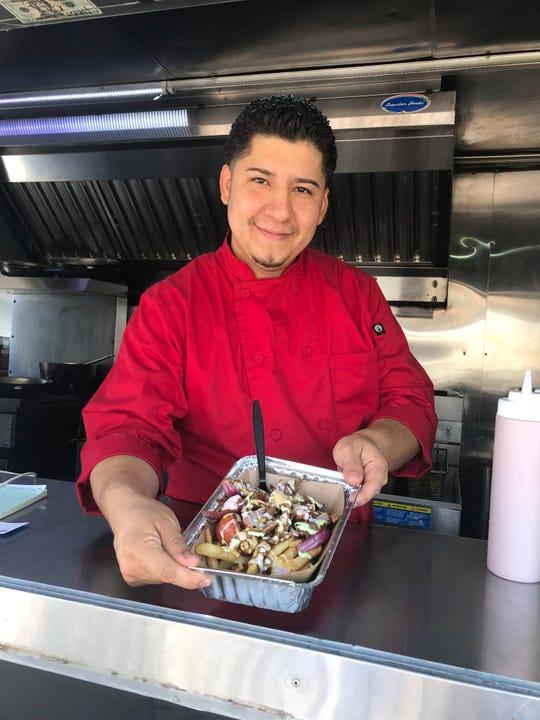 Fabian Marquez of Latusion shows off his famous lomo fries. Photographed Sept. 2018.