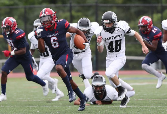 Stepinac's Shawn Harris (6) finds some running room in the Central Dauphin East defense as he runs for a touchdown during football action at Archbishop Stepinac High School in White Plains Sept. 8, 2018. Stepinac won the game 32-14.