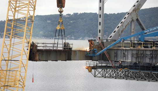 Workers continue to disassemble the old Tappan Zee Bridge on Friday.