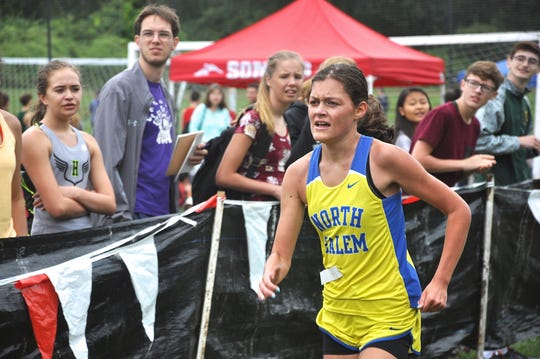 North Salem's Ava Jolley heads for finish and D-3 girls Big Red cross-country meet win..