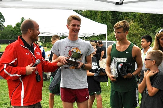 Somers Coach Jesse Arnett L Presents Tim Fulton Cup To Arlingtons Colin Waters As Brewsters Ryan Neubauer R Looks On