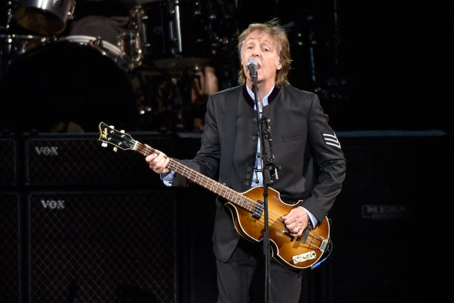 """FILE - In this July 26, 2017 file photo, Paul McCartney performs on the One on One Tour at the Hollywood Casino Amphitheatre in Tinley Park, Illinois. Commuters with tickets to ride out of New York's Grand Central heard a special serenade on Friday evening, Sept. 7, 2018, with McCartney taking over a corner of the majestic hub for a concert. It was a stunt to promote a new album called """"Egypt Station."""""""