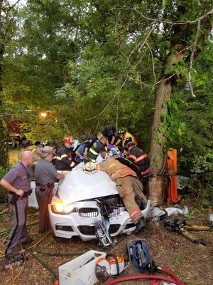 It took dozens of first responders to free the driver and keep him alive during a two-hour extrication.