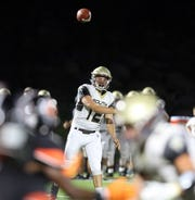 Clarktown South's quarterback Drew Tallevi throws a pass to his teammates during football game at Spring Valley High School on Sept. 7, 2018.