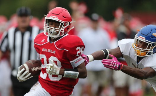 North Rockland's Izaiah Battle (28) scores a touchdown during their 26-14 win over Mahopac at North Rockland High School in Thiells on Saturday, September 8, 2018.