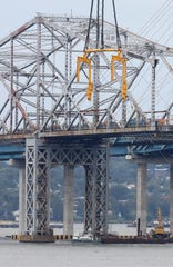 A boat carrying passengers sits near the support structures beneath the old Tappan Zee Bridge, Sept. 8, 2018.