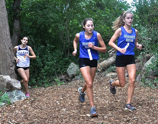 Hen Hud's Sarah Mandelkow and Isodle McManus exit the woods at Big Red cross-country invitational.