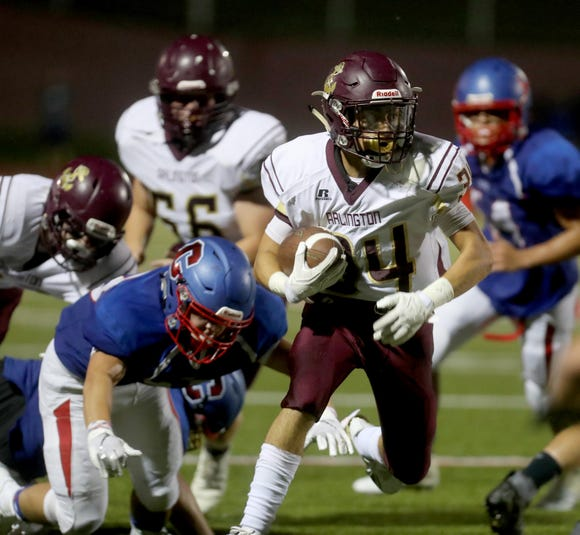 Arlington's Louis Mezzone rushes against Carmel during a varsity football game at Carmel High School Sept. 7, 2018. Arlington defeated Carmel 10-7.