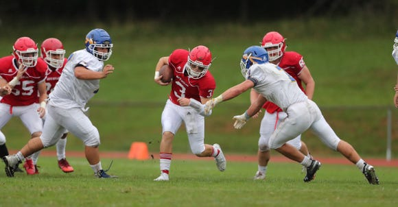 North Rockland's Jeff Abrams (3) looks for a hole during their 26-14 win over Mahopac  at North Rockland High School in Thiells on Saturday, September 8, 2018.