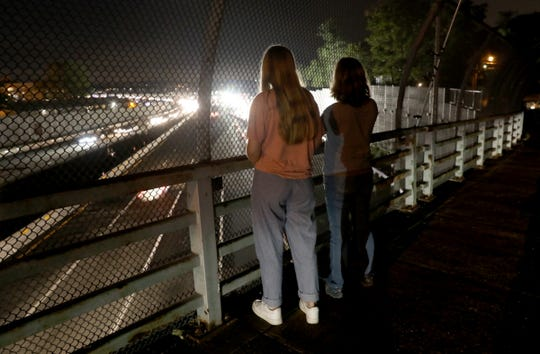 Eleanore Gilpin, left, and Sarah Tucker of Nyack watch the prep work on the entrance to the Gov. Mario M. Cuomo Bridge's eastbound span from South Nyack on Friday, Sept. 7, 2018.