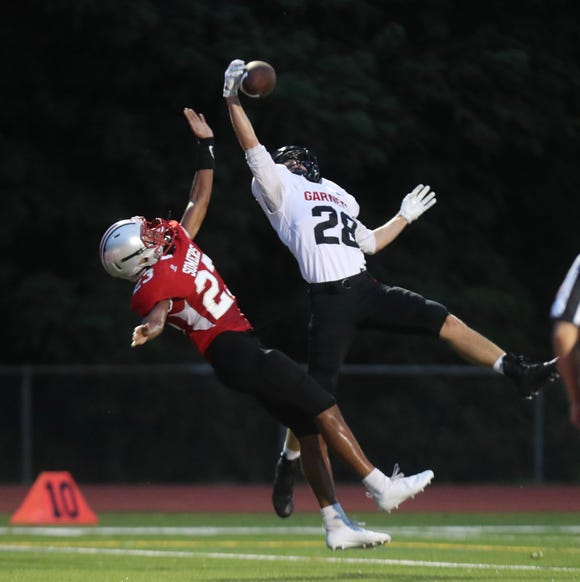 Rye's Quinn Kelly grabs an interception in the Somers end zone during a football game at Somers High School on Friday, September 7th, 2018.